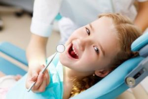 Smiling child in the dental chair