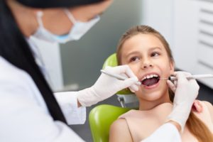 a young girl at the dentist