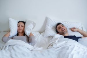 Snoring man with sleep apnea