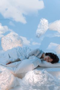 Woman sleeping in the clouds